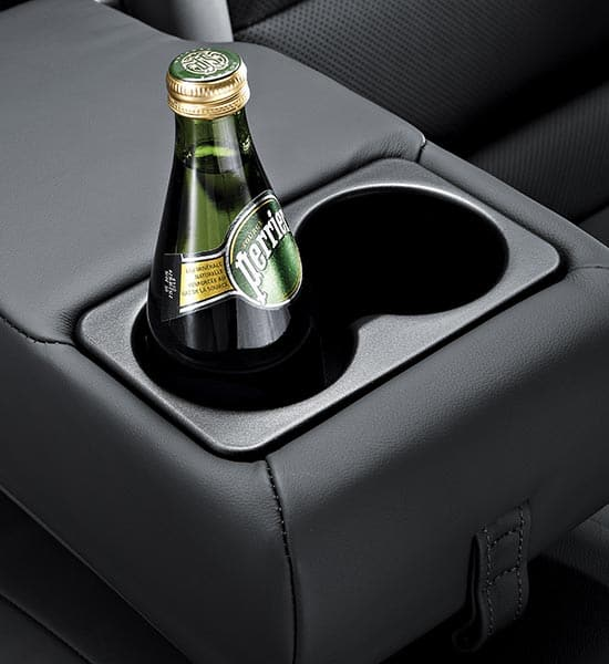 Rear center armrest with cup holders