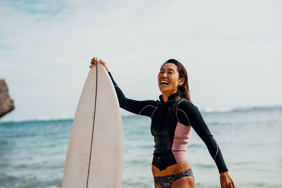 kia-electrification-everywhere-girl-surfing