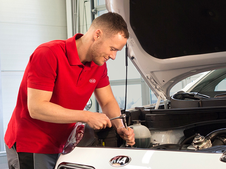 Mechanic focused on the maintenance of the car