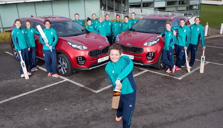 England womens cricket team with two Kia Sportages