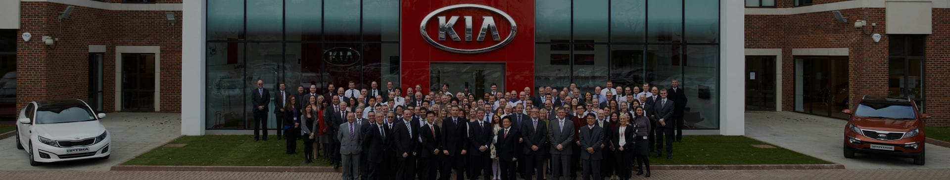 Kia team outside Kia United Kingdom Headquarters