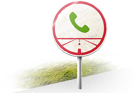 Road sign showing a green telephone over a road