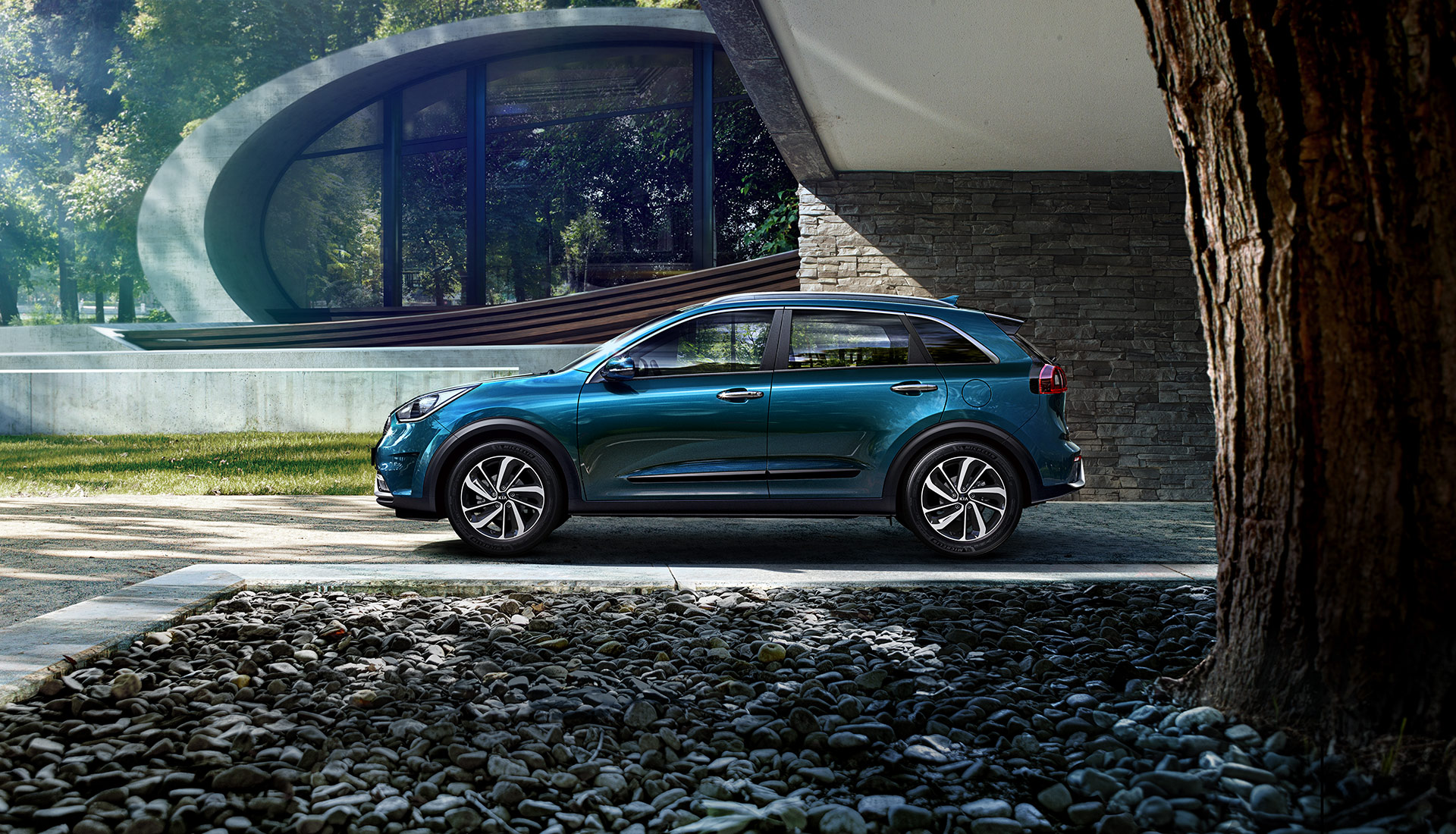 The All-new Niro parked outside of a contemporary house