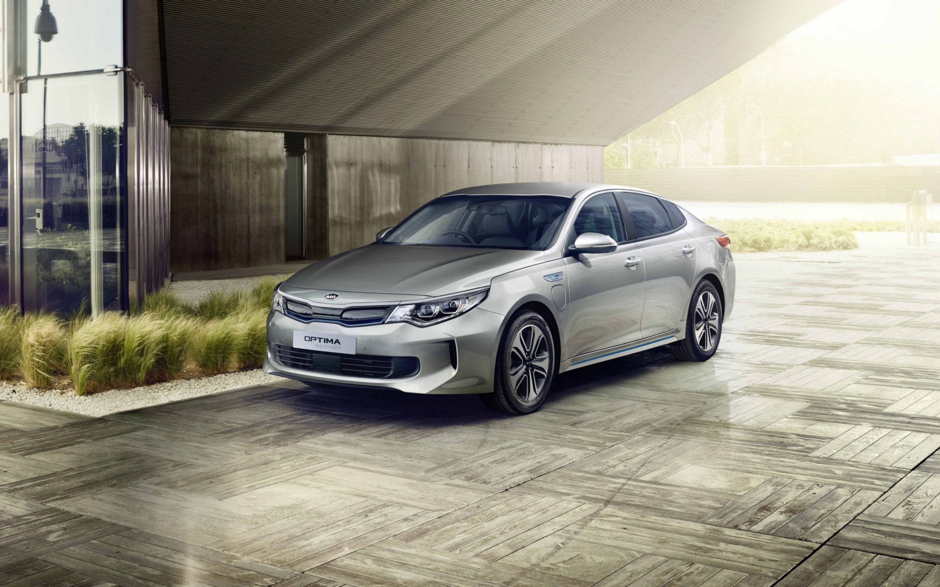 All-New Optima Plug-In Hybrid parked outside of contemporary house