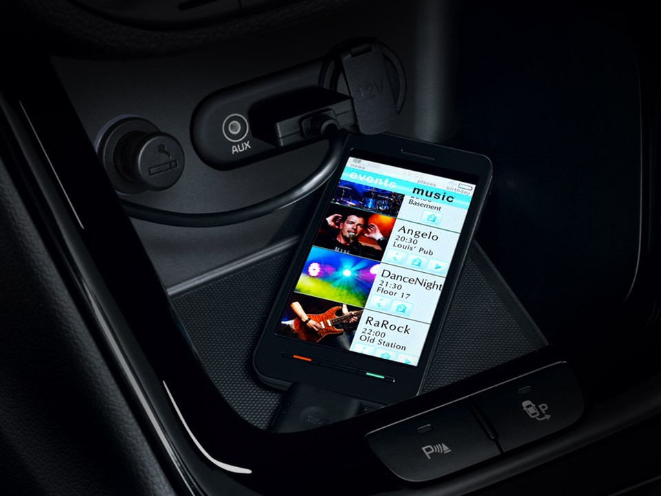 smartphone connected to Kia cee'd dashboard