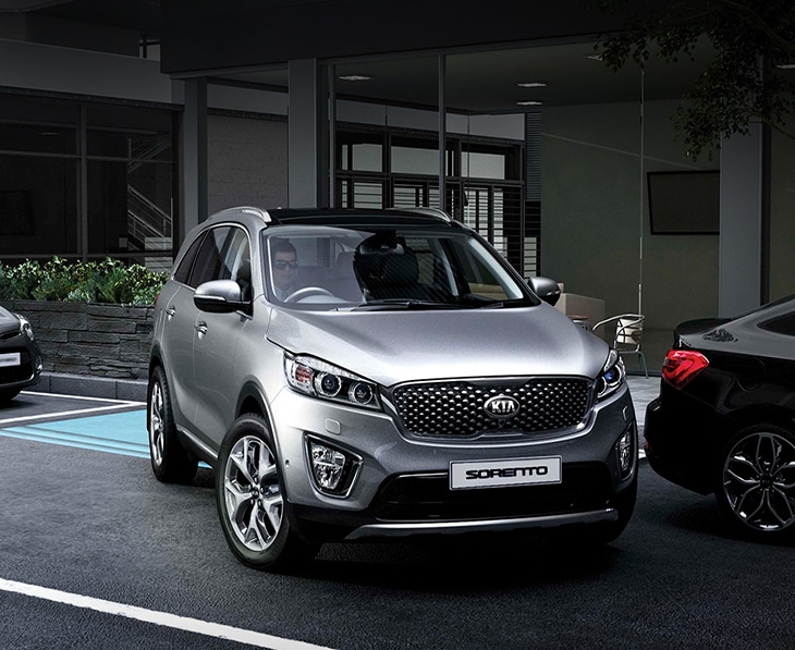 Kia Sorento reversing into a parking space, aided by rear sensors
