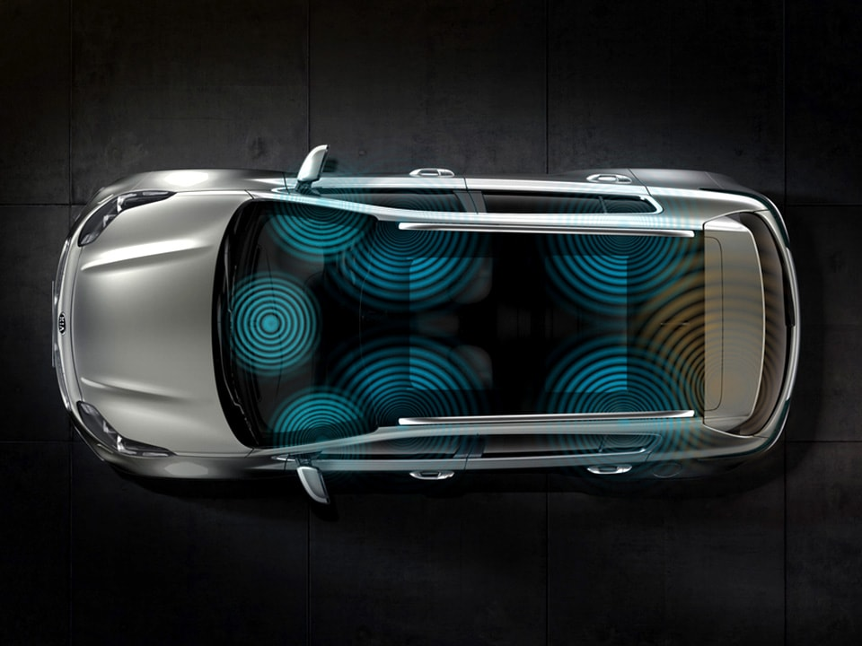 Soundwaves emitting from six points inside an All-New Kia Sportage