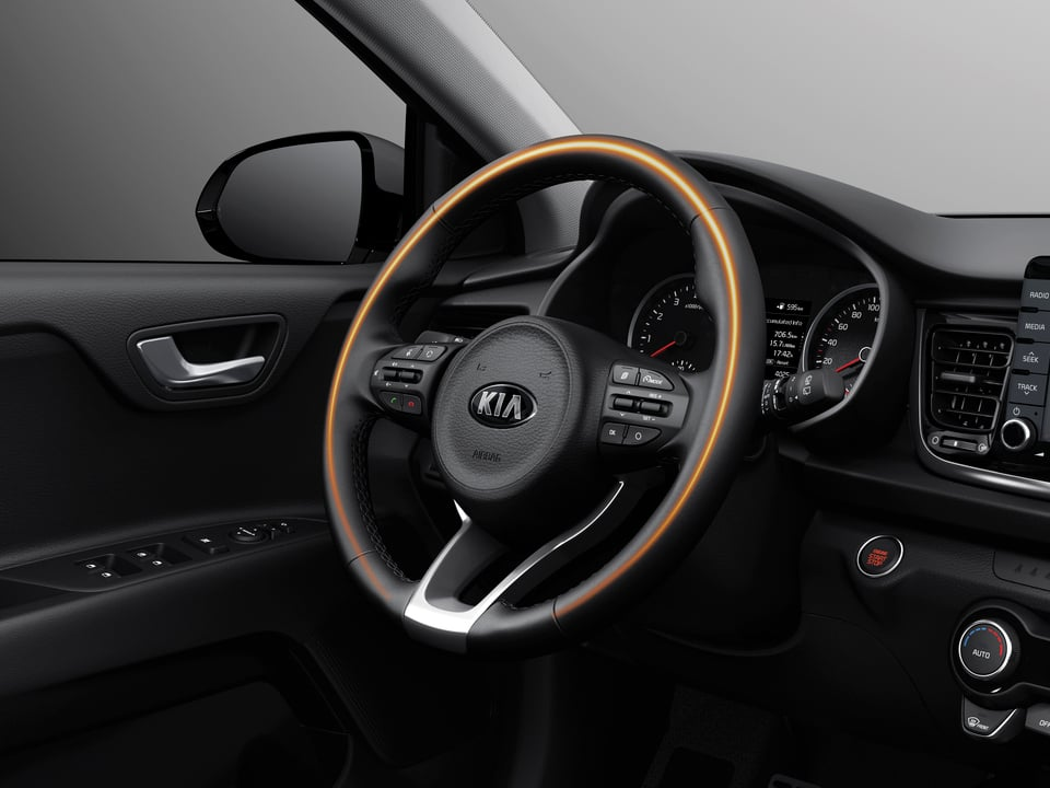 Interior shot of the Rio stearing wheel showing orange glow to illustrate the wheel is heated