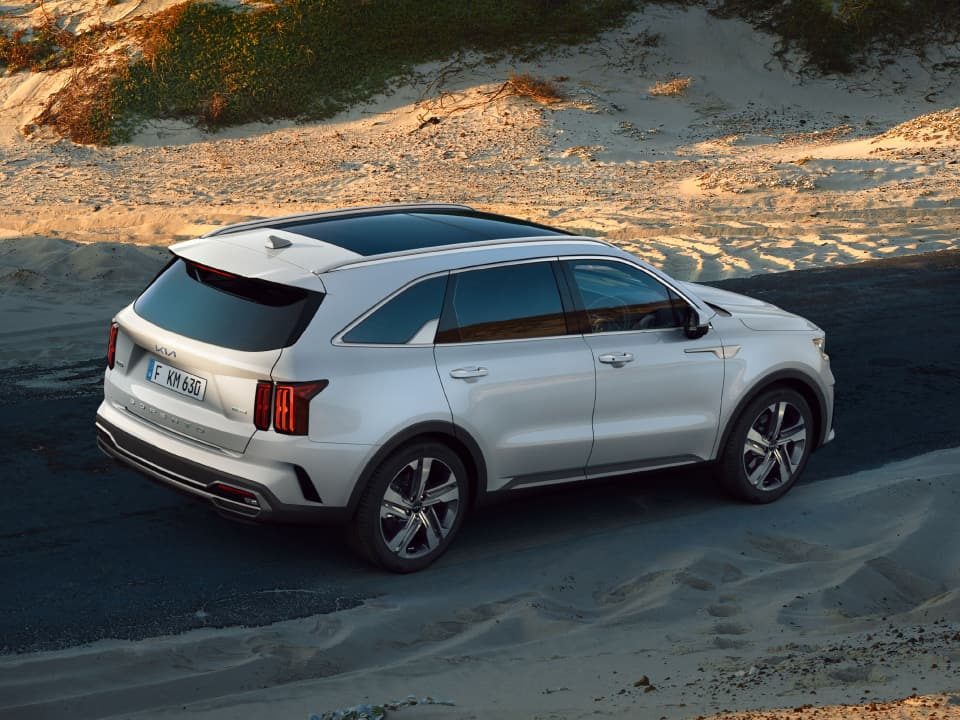 All-new Kia Sorento Hybrid driving through mountains
