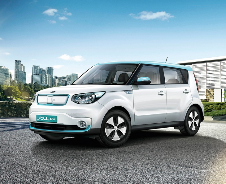Kia Soul EV parked outside a modern building