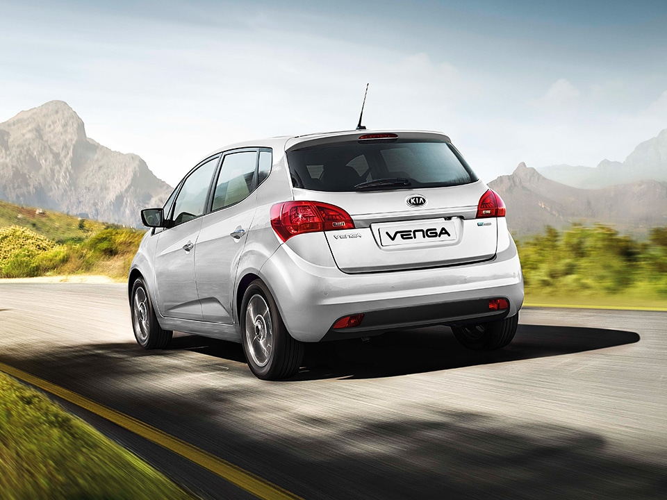 Kia Venga rear and side view driving through countryside