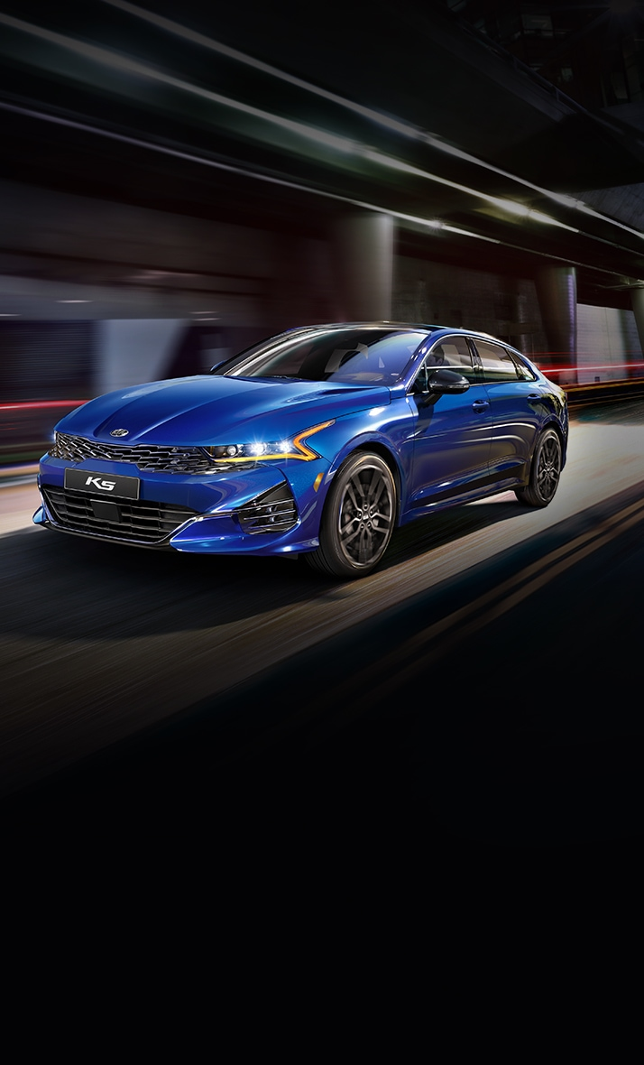 2021 Kia K5 Sporty Mid-Size Sedan Driving