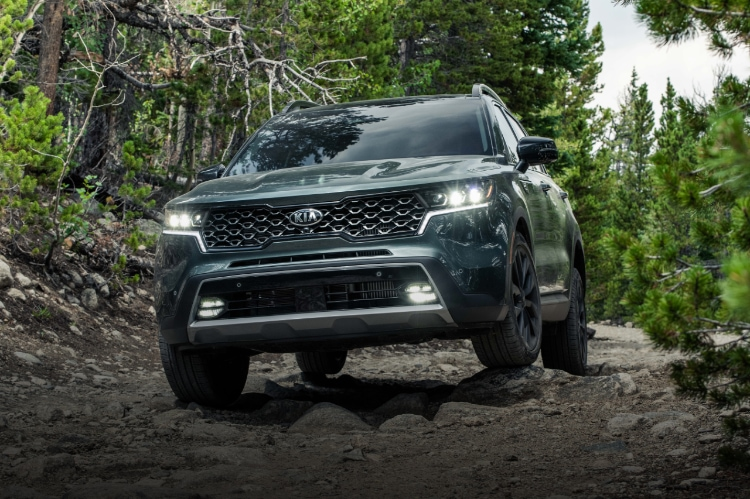 2021 Kia Sorento Driving Over Rocky Terrain In A Forest Front View