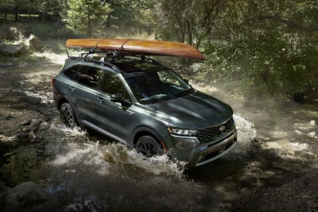2021 Kia Sorento Driving Through A Stream With A Kayak Rack Equipped