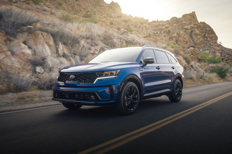 2021 Kia Sorento in blue driving on highway, 3/4 view of front driver side
