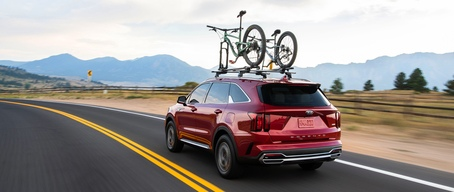 2021 Kia Sorento Hybrid Driving Towards Mountains With A Bike Rack Rear View